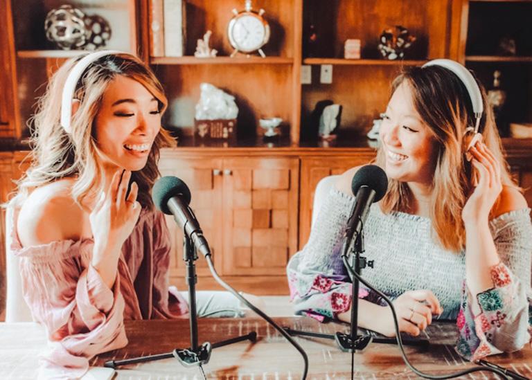 christine and regina recording a podcast